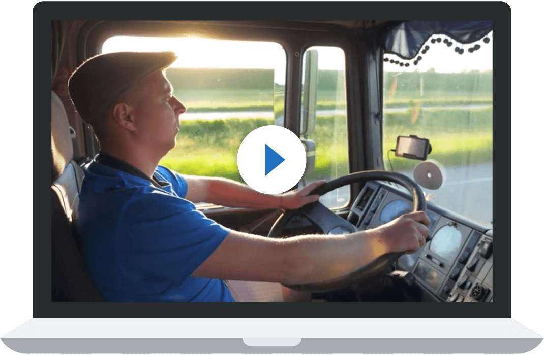 man driving truck looking at road on sunny day