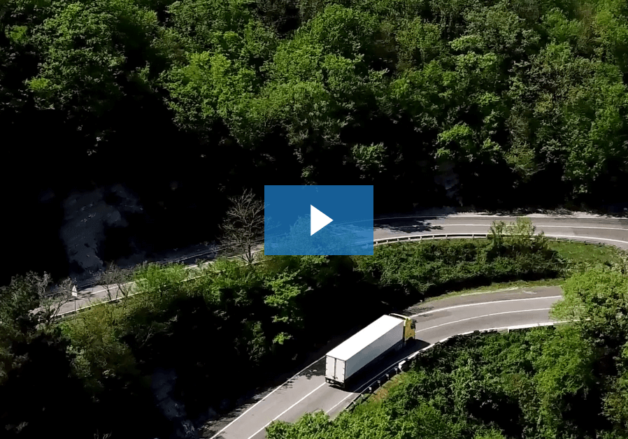 video thumbnail - truck driving down a windy road